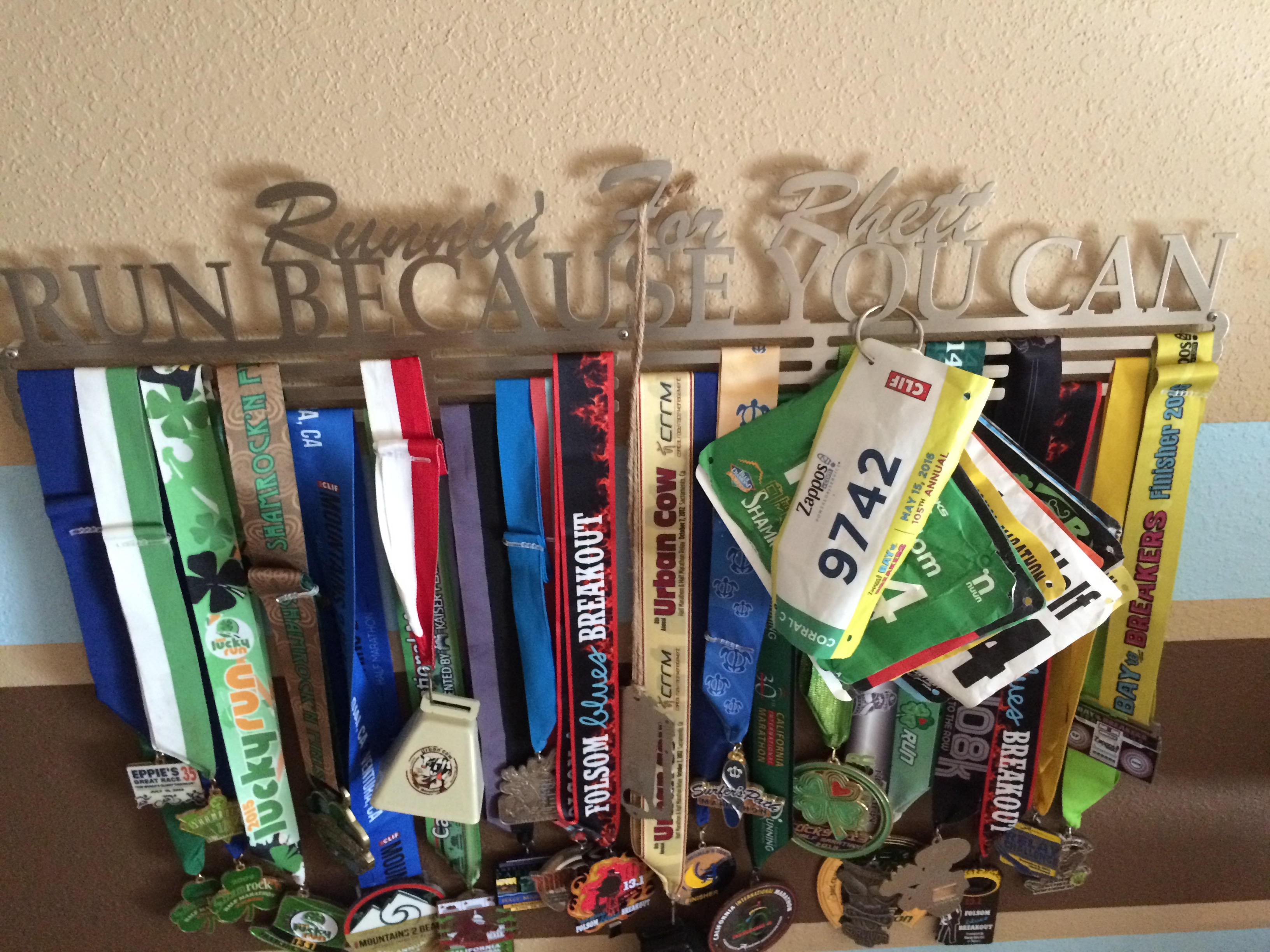 the shelf outrunning race rain about and display diy bib medal cost